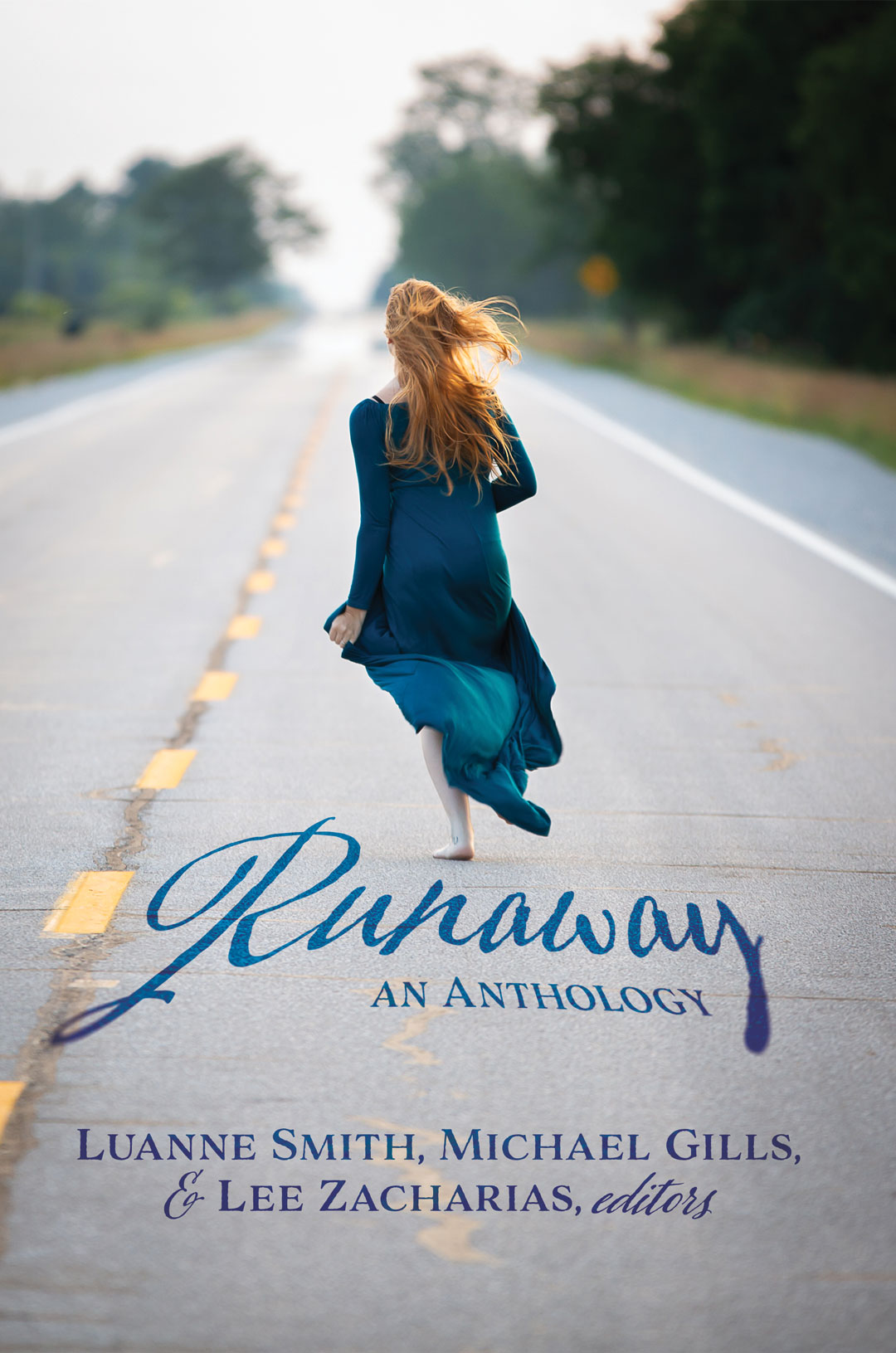 Front cover for Runaway: An Anthology edited by Luanne Smith, Michael Gills, and Lee Zacharias. It shows a woman in a long dress of a rich aqua color running barefooted down the middle of a desolate two-lane highway. She has long red hair flowing out behind her.