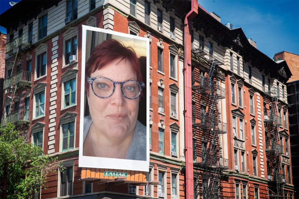 Luanne Smith's portrait as a billboard on the corner of a brik building like you'd see in Boston or New York.